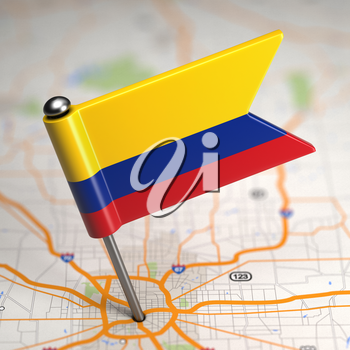 Small Flag of Colombia on a Map Background with Selective Focus.