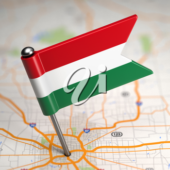 Small Flag of Hungary on a Map Background with Selective Focus.