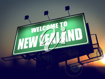 Welcome to New Zealand - Green Billboard on the Rising Sun Background.
