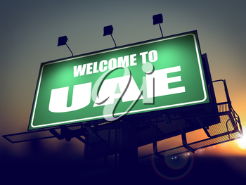 Welcome to UAE - Green Billboard on the Rising Sun Background.