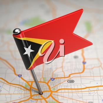 Small Flag of Democratic Republic of Timor-Leste on a Map Background with Selective Focus.
