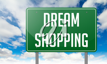 Highway Signpost with Dream Shopping wording on Sky Background.