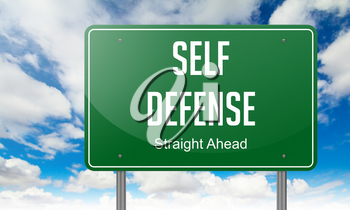 Highway Signpost with Self Defense wording on Sky Background.