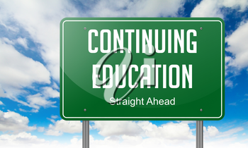 Highway Signpost with Continuing Education wording on Sky Background.