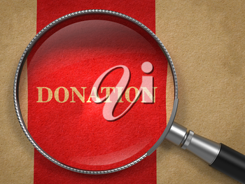 Donation Inscription Through a Magnifying Glass on a Red-Brown Background