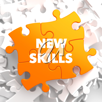 New Skills on Orange Puzzle on White Background.