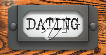 Dating - Inscription on File Drawer Label on a Wooden Background.