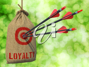 Loyalty - Three Arrows Hit in Red Target on a Hanging Sack on Green Bokeh Background.