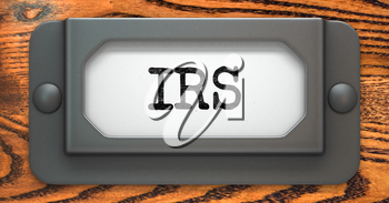 IRS Inscription on File Drawer Label on a Wooden Background.