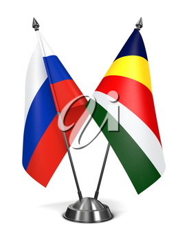 Russia and Seychelles - Miniature Flags Isolated on White Background.