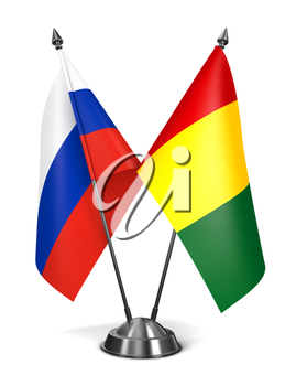 Royalty Free Clipart Image of a Russia and Guinea Miniature Flags