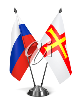 Russia and Guernsey - Miniature Flags Isolated on White Background.