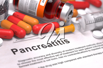 Pancreatitis - Printed Diagnosis with Blurred Text. On Background of Medicaments Composition - Red Pills, Injections and Syringe.