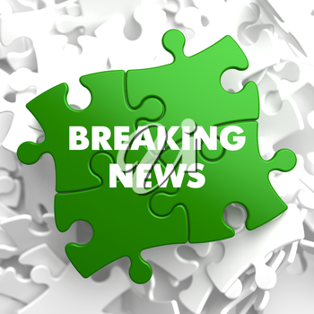 Breaking News on Green Puzzle on White Background.