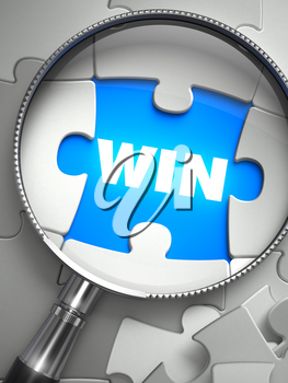 Win - Word on the Place of Missing Puzzle Piece through Magnifier. Selective Focus.