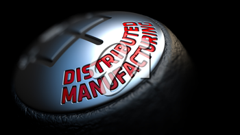 Gear Stick with Red Text Distributed Manufacturing on Black Background. Close Up View. Selective Focus. 3D Render.
