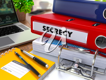 Red Ring Binder with Inscription Secrecy on Background of Working Table with Office Supplies, Laptop, Reports. Toned Illustration. Business Concept on Blurred Background.