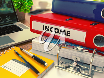 Red Office Folder with Inscription Income on Office Desktop with Office Supplies and Modern Laptop. Business Concept on Blurred Background. Toned Image.