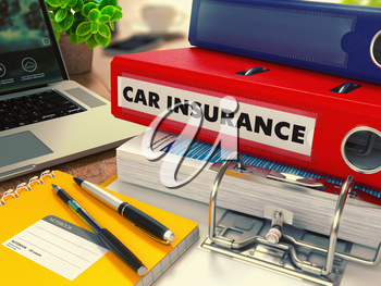 Red Office Folder with Inscription Car Insurance on Office Desktop with Office Supplies and Modern Laptop. Business Concept on Blurred Background. Toned Image.
