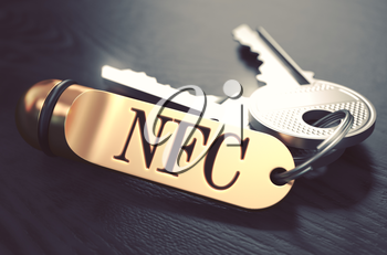 Keys and Golden Keyring with the Word NFC - Near Field Communication - over Black Wooden Table with Blur Effect. Toned Image.