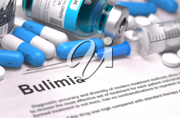 Diagnosis - Bulimia. Medical Concept with Blue Pills, Injections and Syringe. Selective Focus. Blurred Background.