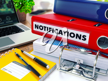 Notifications - Red Ring Binder on Office Desktop with Office Supplies and Modern Laptop. Business Concept on Blurred Background. Toned Illustration.