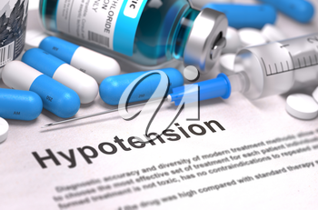 Diagnosis - Hypotension. Medical Report with Composition of Medicaments - Blue Pills, Injections and Syringe. Blurred Background with Selective Focus.