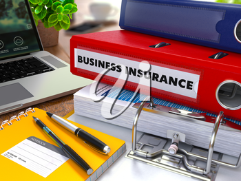 Red Ring Binder with Inscription Business Insurance on Background of Working Table with Office Supplies, Laptop, Reports. Toned Illustration. Business Concept on Blurred Background.