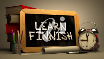 Hand Drawn Learn Finnish Concept  on Chalkboard. Blurred Background. Toned Image.