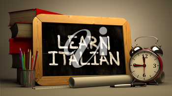 Learn Italian Concept Hand Drawn on Chalkboard. Blurred Background. Toned Image.