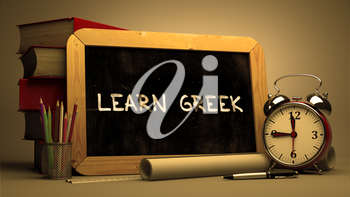 Hand Drawn Learn Greek Concept  on Chalkboard. Blurred Background. Toned Image.