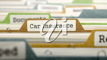 File Folder Labeled as Car Insurance in Multicolor Archive. Closeup View. Blurred Image.