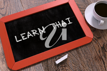 Hand Drawn Motivational Quote - Learn Thai - on Small Red Chalkboard. Business Background. Top View.