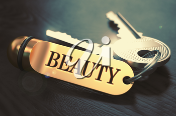 Beauty - Bunch of Keys with Text on Golden Keychain. Black Wooden Background. Closeup View with Selective Focus. 3D Illustration. Toned Image.