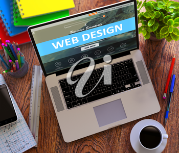 Web Design Concept. Modern Laptop and Different Office Supply on Wooden Desktop background.