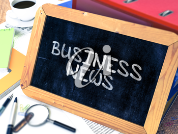 Business News Concept Hand Drawn on Chalkboard on Working Table Background. Blurred Background. Toned Image.