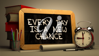 Every Day is a New Chance.  Inspirational Quote Hand Drawn on Chalkboard. Blurred Background. Toned Image.