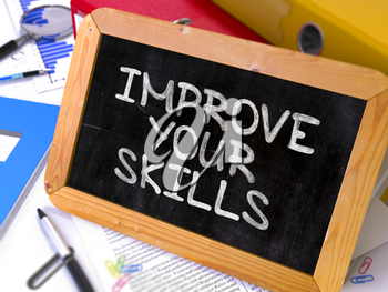 Improve Your Skills. Motivation Quote Hand Drawn on Chalkboard on Working Table Background. Blurred Background. Toned Image.