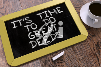 It's Time to Do Great Deeds - Yellow Chalkboard with Hand Drawn Motivation Quote and White Cup of Coffee on Wooden Table. Top View.