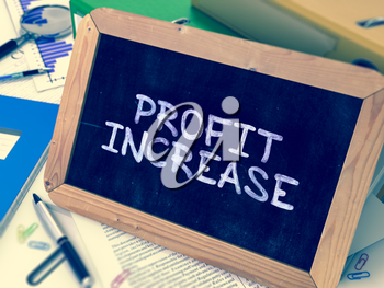 Hand Drawn Profit Increase Concept  on Chalkboard. Blurred Background. Toned Image.