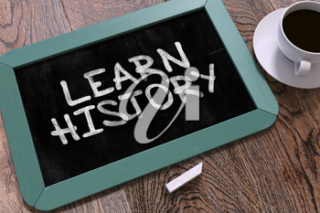 Learn History Concept Hand Drawn on Blue Chalkboard on Wooden Table. Business Background. Top View. 3d Render.