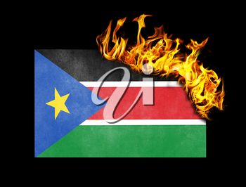 Flag burning - concept of war or crisis - South Sudan