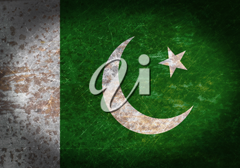 Old rusty metal sign with a flag - Pakistan