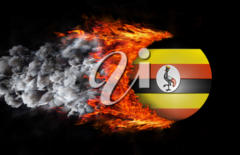 Concept of speed - Flag with a trail of fire and smoke - Uganda