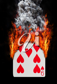 Playing card with fire and smoke, isolated on white - Nine of hearts