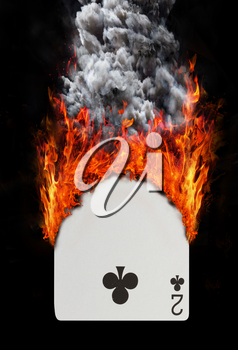 Playing card with fire and smoke, isolated on white - Two of clubs