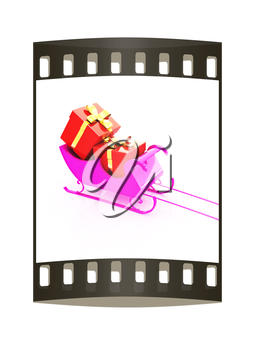 Christmas Santa sledge with gifts on a white background. The film strip