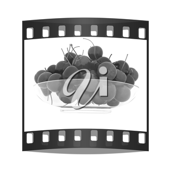 Sweet cherries on a plate on a white background. The film strip