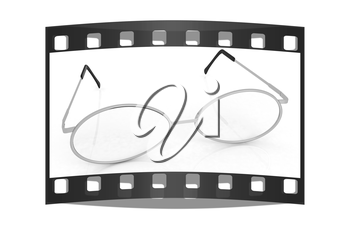 glasses on a white background. The film strip
