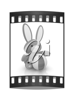 soft toy hare and colorful aquatic ball on a white background. The film strip
